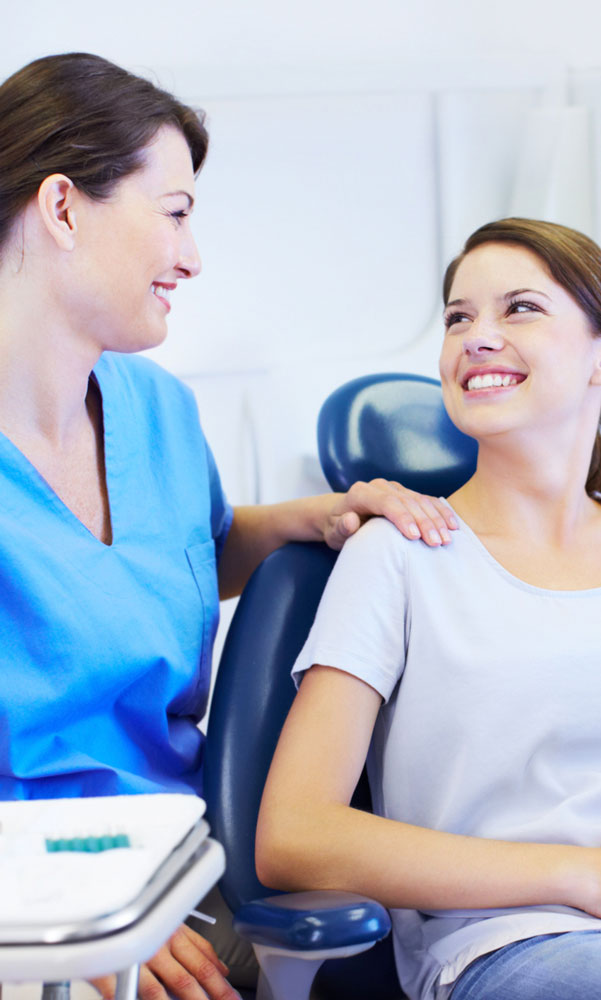 Dental Nurse talking to female patient | Cape Charles Dentistry